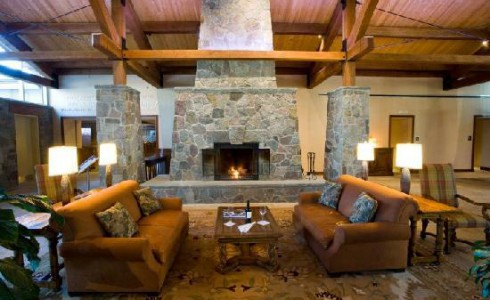 Hotel Lobby with Fireplace and Exposed Beams