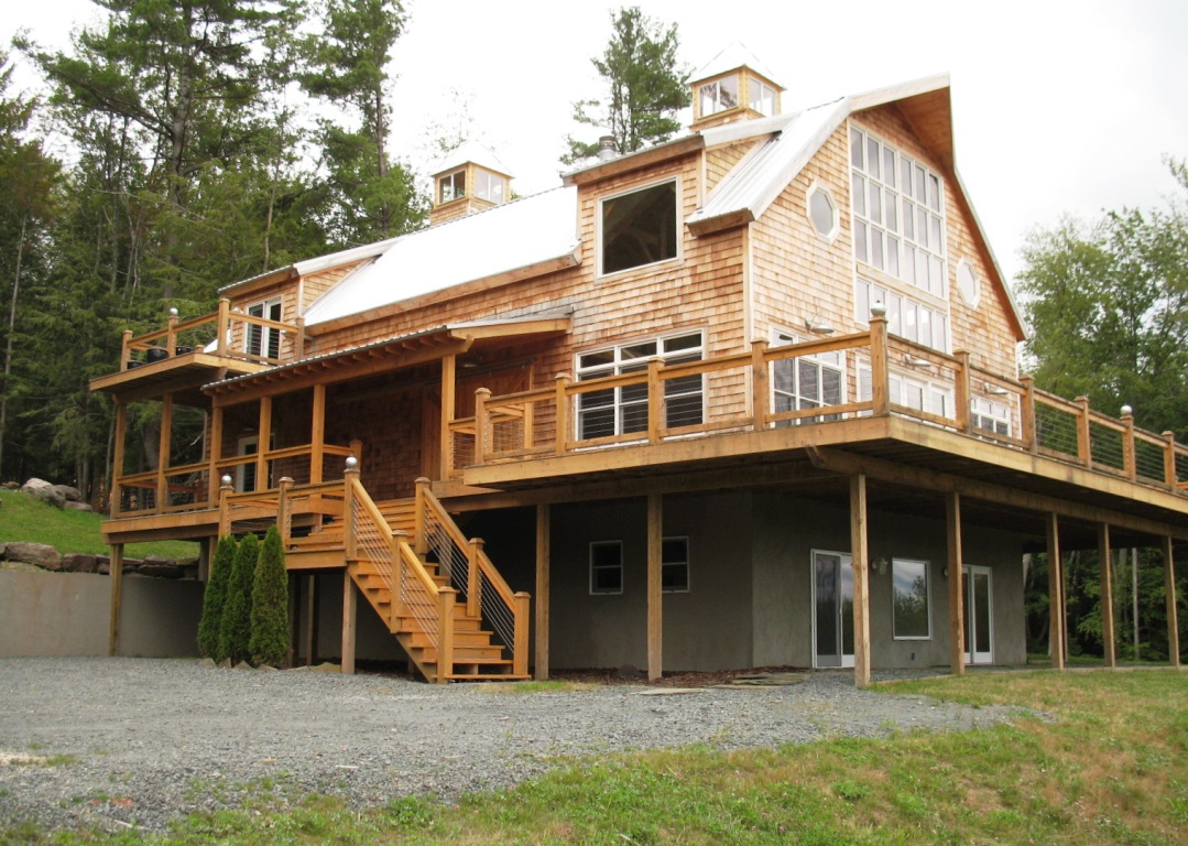 Gambrel style post beam house for Barn frame homes