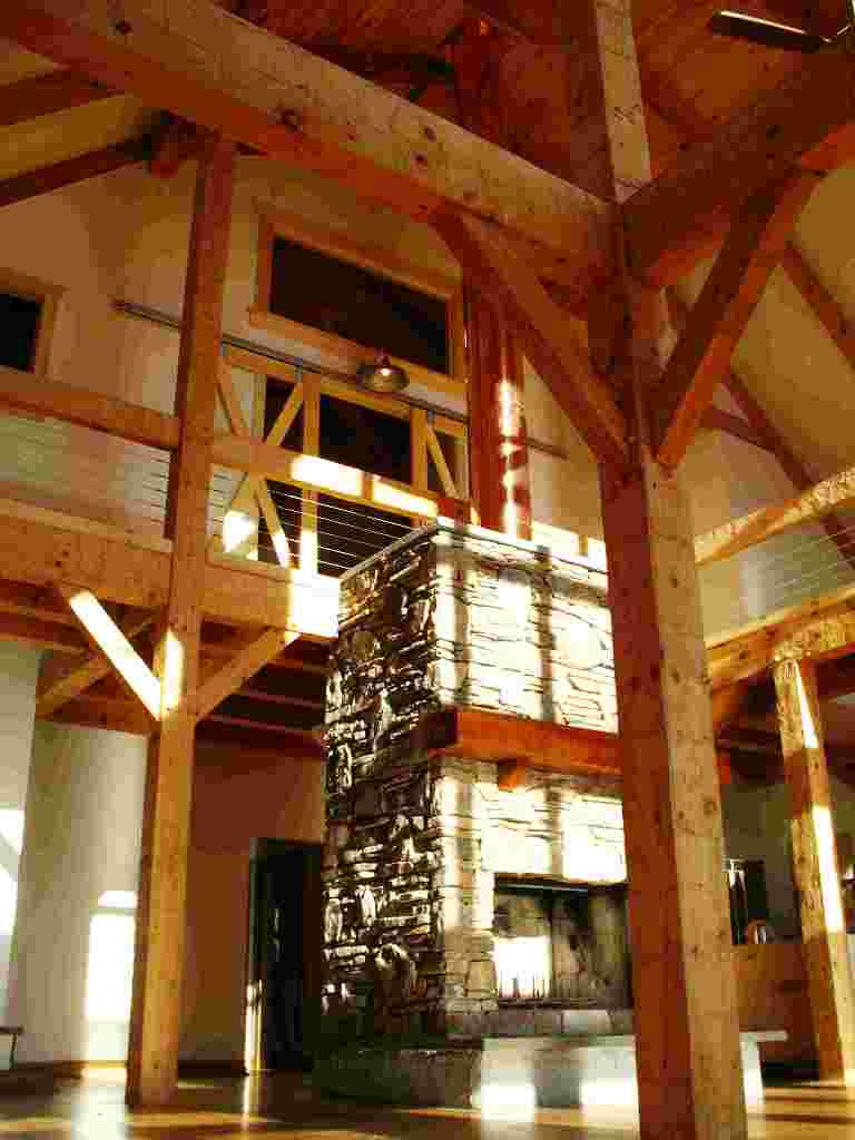 Timber frame barn home hand hewn beams for Timber frame home interiors