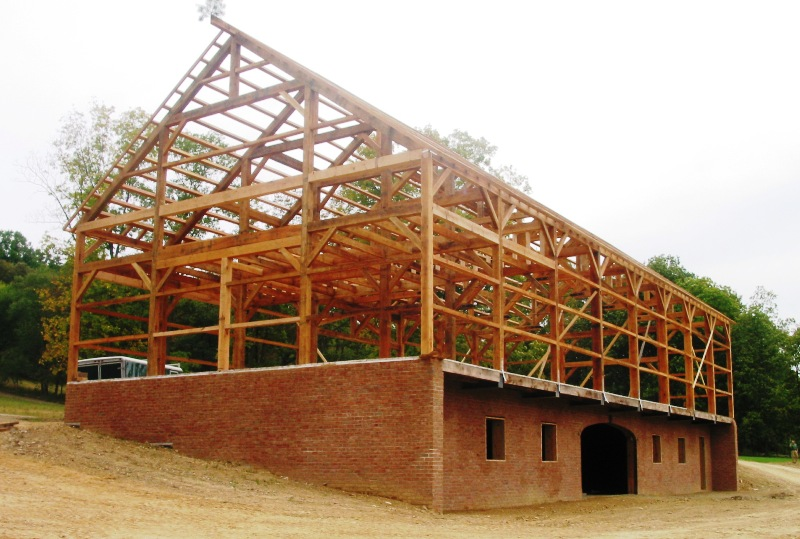 Traditional timber frame native oak beams steel tie rods for Metal frame barn