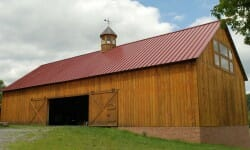 Timber Equipment Barn Exterior with Sliding Barn Doors