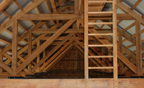 Timber Roof Trusses in the Interior of Rich Barn