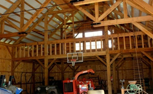 Rich Barn Interior with Tractors and Other Equipment