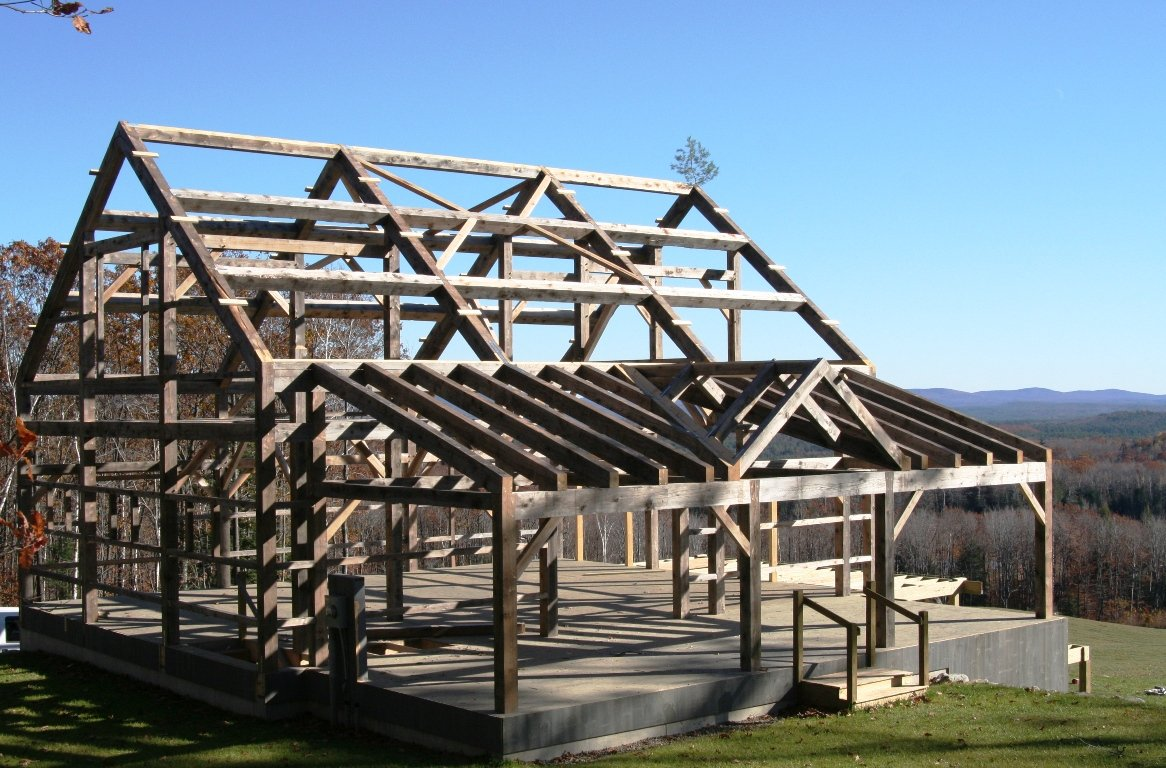 Weathered timber frame barn antiqued post beam barn for Barn frame homes