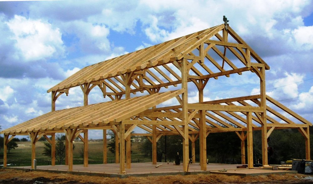 Equipment barn in tx with hemlock frame and curved braces for Post and beam shed plans