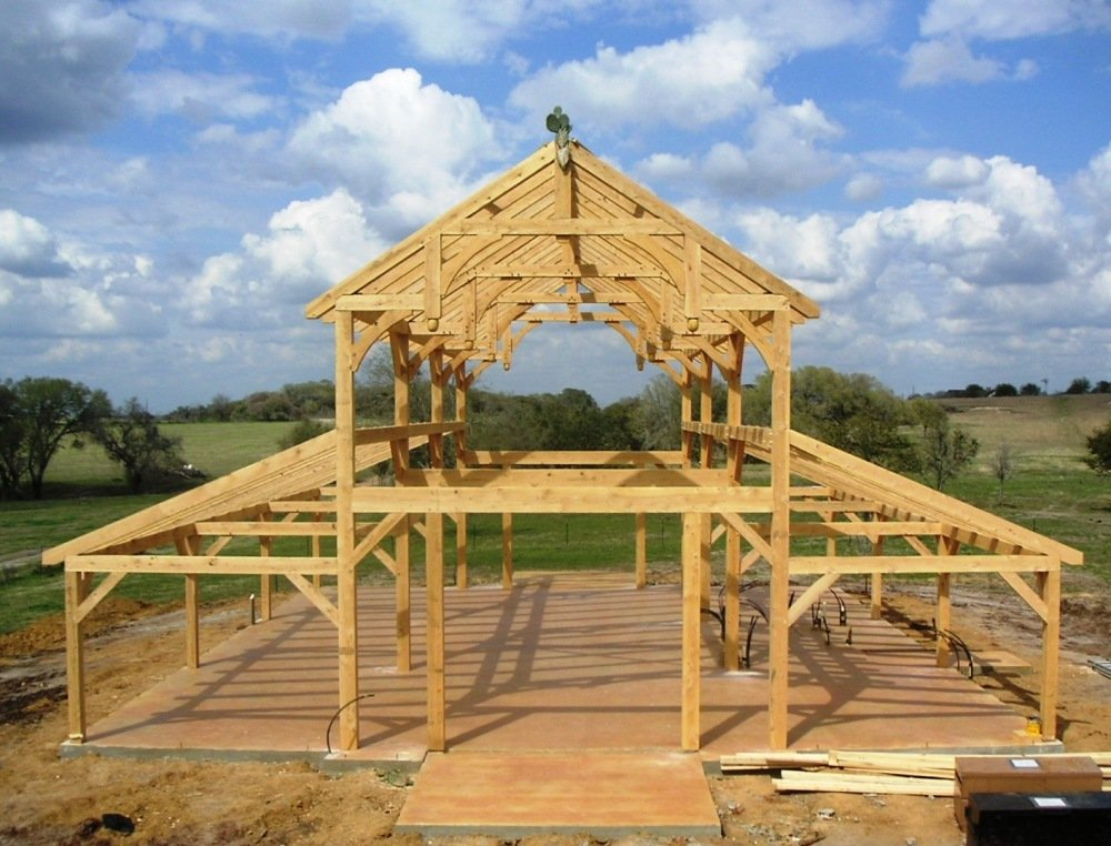 Equipment barn in tx with hemlock frame and curved braces for Pole frame house plans