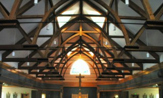 Douglas Fir Heavy Timber Trusses with Arched Beams and Steel Tie Rod