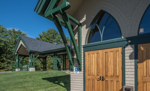 Exterior of Our Lady of the Mountains Church with Porte Cochere in NH