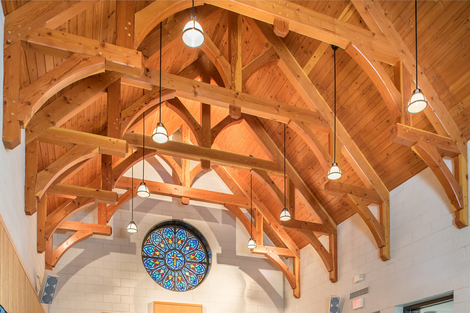 Interior of Westminster Presbyterian Church with Hammer Trusses and Stained Glass window