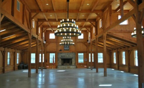 Beautiful Heavy Timber Dining Hall with Stone Fireplace