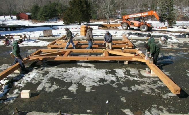 Timber Framers Preparing to Raise Dining Hall Frame