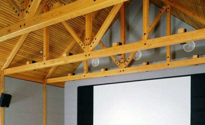 Queen Post Truss using Concealed Steel Knife Plates and Naturally Stained Douglas Fir Timbers in Woodstock, VT.