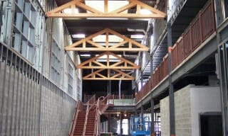 Wood King Post Trusses Installed in Westbrook Middle School Interior