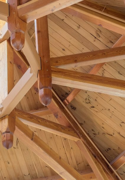 Close up of the steel compression ring and timbers in the Octagon Timber Frame in the Chapel for Holy Apostles