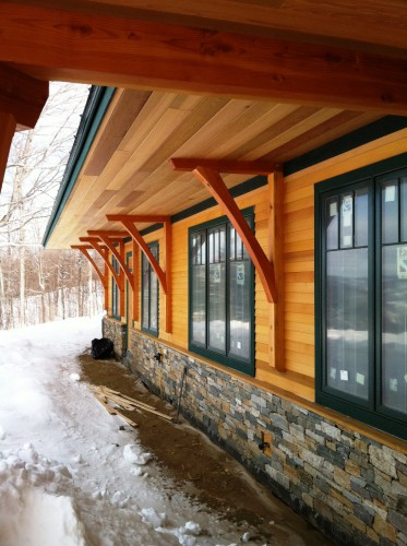 Night pasture farm chelsea vt modern timber home - Exterior structural wood brackets ...
