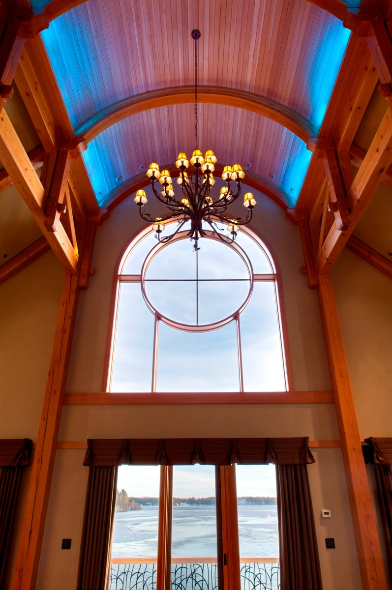 House on the lake exposed ceiling beams modern design for Arched ceiling beams