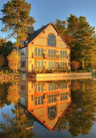 A pretty view of a timber lake house