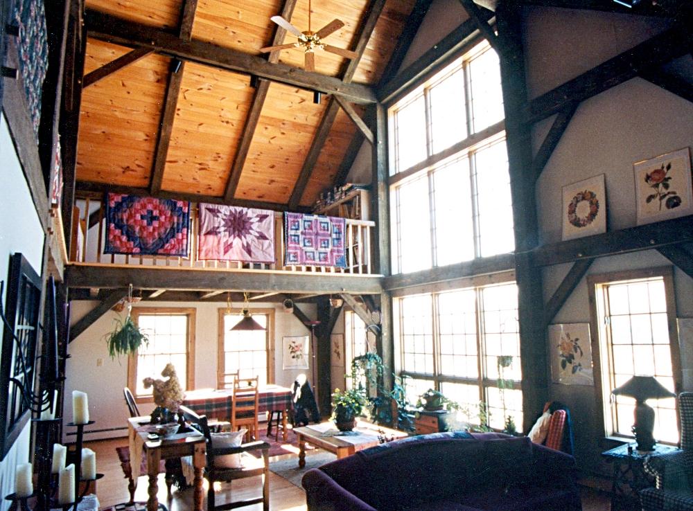 Post beam frame for the simon residence saltbox timber home for Barn house interior