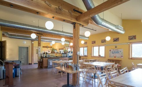 Interior Timber Frame Cafe with Steel Brackets in the Badger Balm Factory in Gilsum, NH