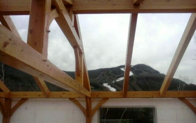Timber Rafters With a Great View of a Ski Mountain