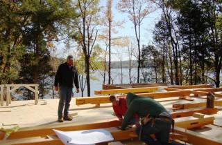 Crew Assembling Timber Home