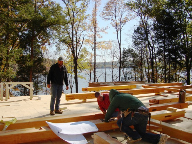 Crew Assembling Timber Home