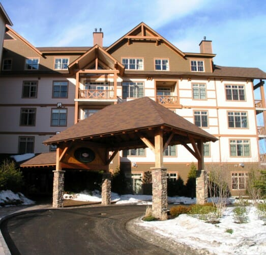 Timber frame porte cochere for founders lodge stratton vt for What is a porte cochere