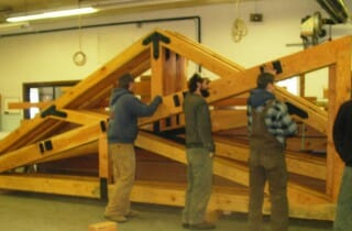 Vermont Timber Workers Assembling Trusses