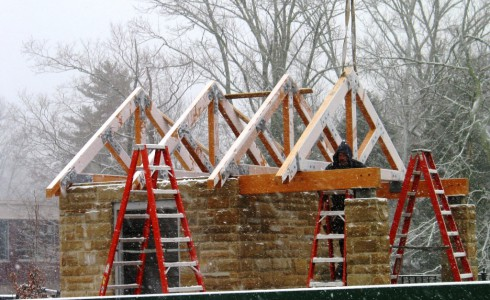 Vermont Timber Workers Installing Trusses in the Snow