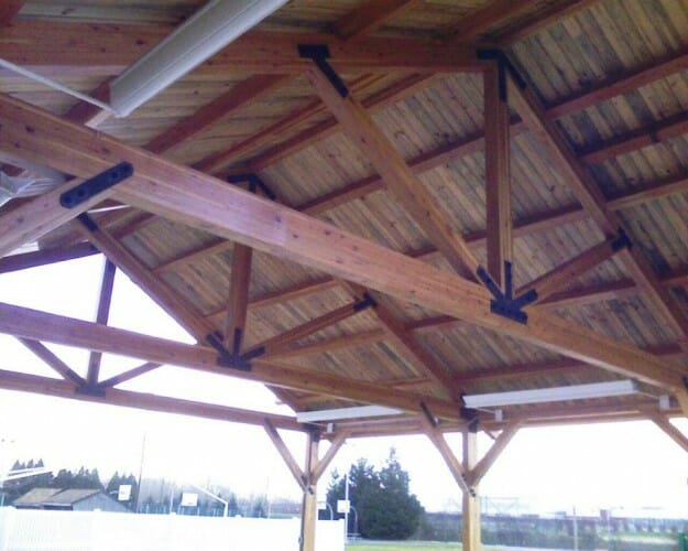 Navy picnic pavilion king post trusses glu laminated for Custom roof trusses