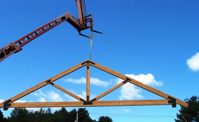 Crane Lifting a Timber Truss