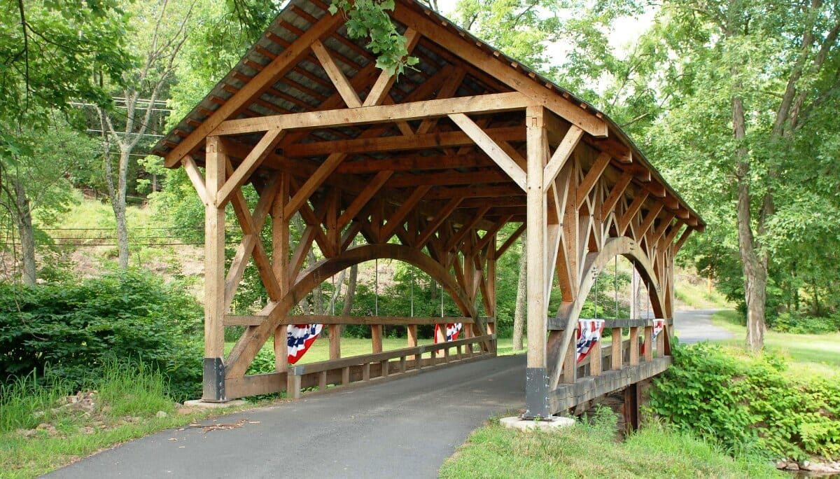 Rich bridge custom covered rough sawn red oak for Timber frame bridge