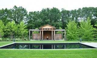A Pergola Style Pool House Made of Chamfered Douglass Fir