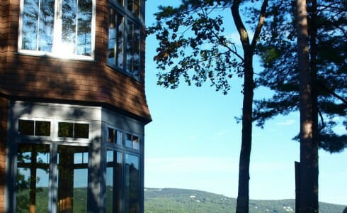 Adirondack Style Exterior of a Home with a Post & Beam Interior