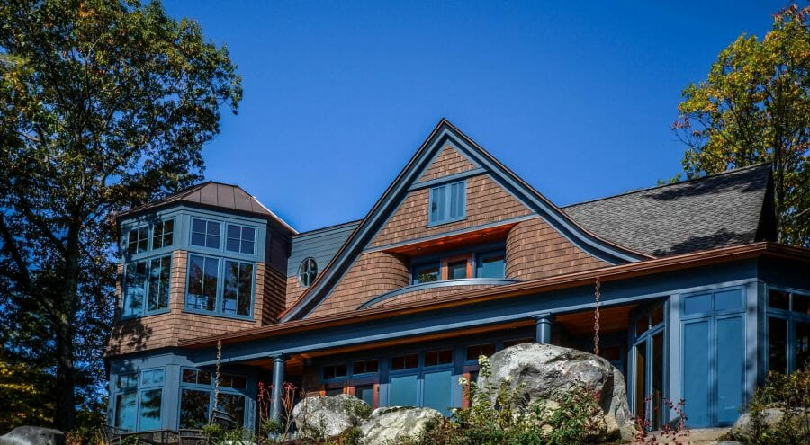 Two examples of design build with vermont timber works for Adirondack style home plans