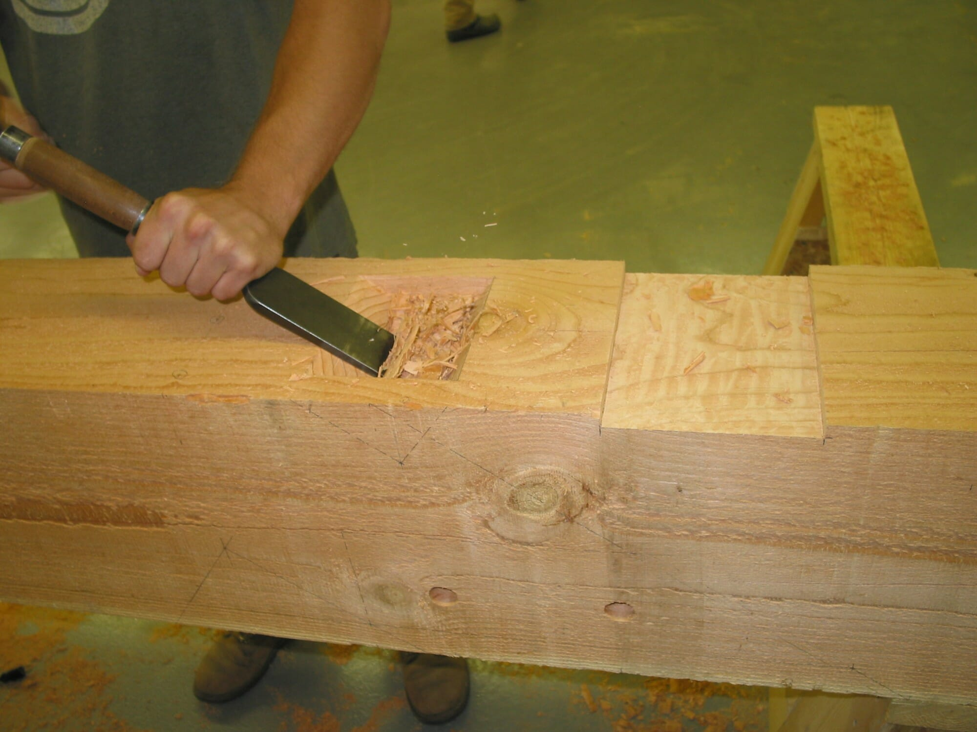 Chiseling out a pocket in a timber