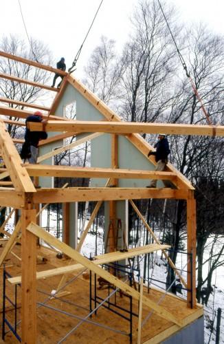 timber-frame-assembly-raising-purlin-installation