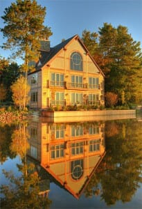 timber frame hybrid reflection in lake