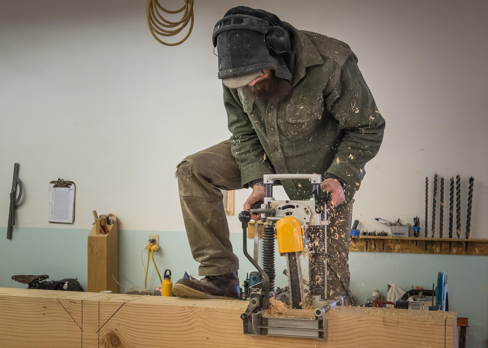 Timber Frame Fabrication Mortiser in work shop