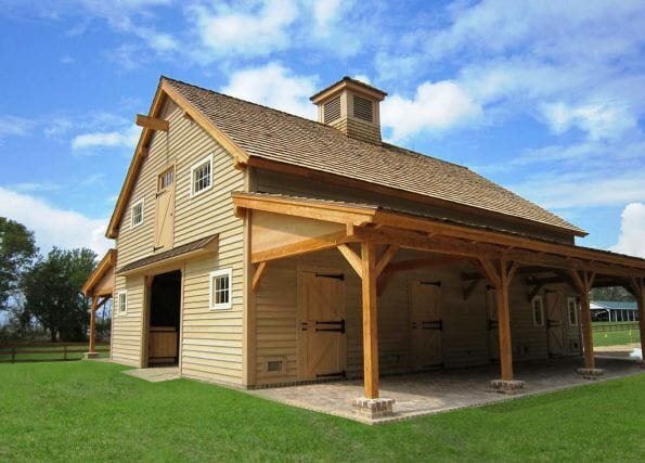 Beautiful timber frame horse barn with high end finishes for Post and beam shed plans