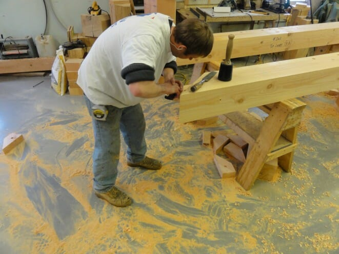 Jake cleaning up a tenon.