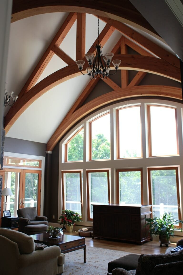 Timber frame home arched wood trusses for Timber trusses for sale