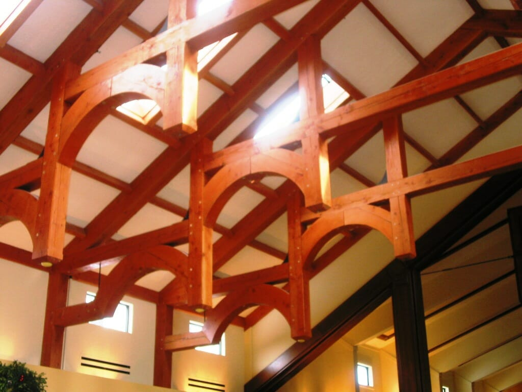 Elegant post and beam church vermont timber works for Arched ceiling beams