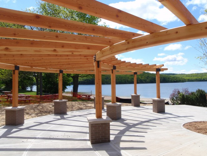 Beautiful Curved Timber Pergola Overlooking a Lake
