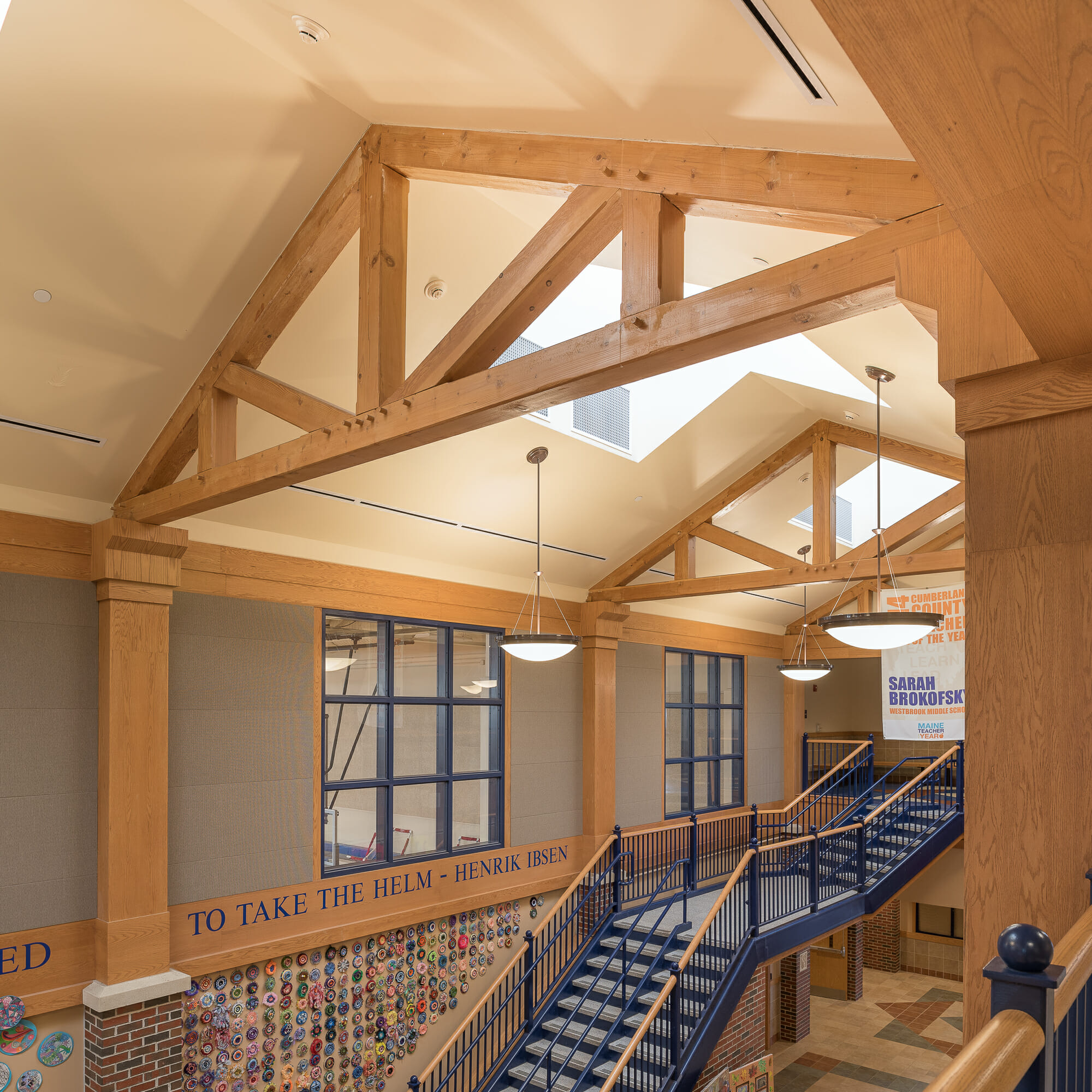 Interior of Westbrook Middle School with King post trusses in ME
