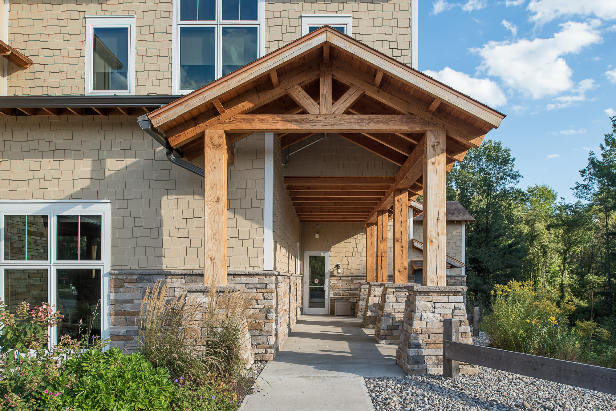 Timber framed porte cochere for pediatric dentistry in ny for What is a porte cochere