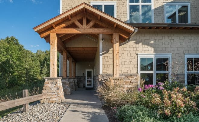 Heavy Timber Porte Cochere Entry Way with King Posts Outside of a Pediatric Dentist Office