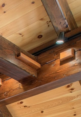 Black Cherry Keys and Steel Straps on Timber Beams in a Barn Style Home in NH