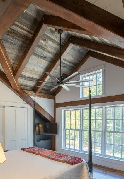 Interior Bedroom with overhead Beams in a Barn Style Home in NH