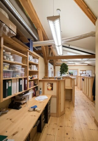 A Work Space with Timber Beams in the Badger Balm Factory in Gilsum, NH
